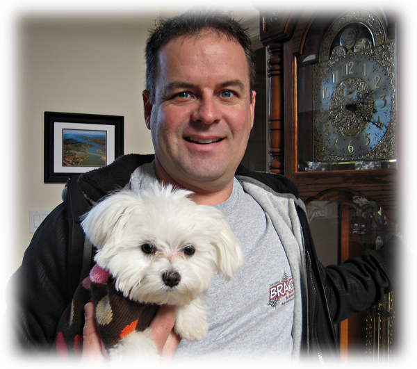 "Retired NASCAR driver Jerry Nadeau with his Maltese Forever dog, ""Poppy""!"